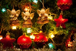 Musician angels hanging on the Christmas tree, close up
