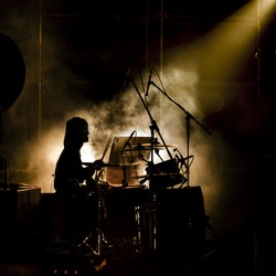 Musician drummer silhouette in the concert
