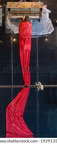 musician during theatrical performance in  art gallery - mirror ceiling reflection
