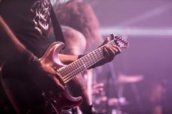 Musician, guitarist playing electric guitar