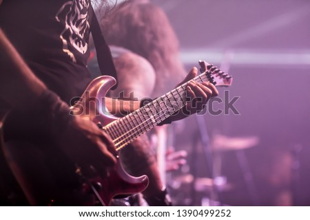Musician, guitarist playing electric guitar #1390499252