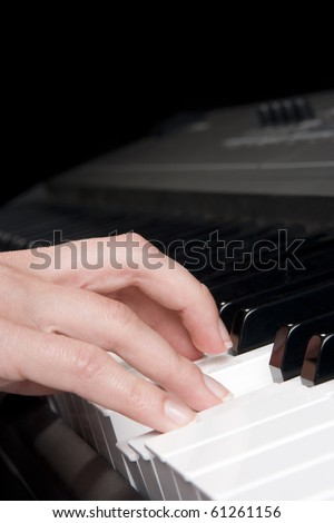 Musician play piano synthesizer - piano key and woman hand closeup