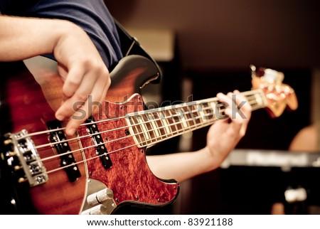 musician playing a bass guitar - stock photo