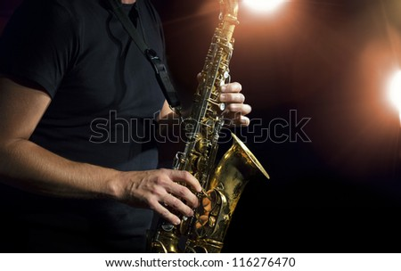 Musician playing alto saxophone on a gig.