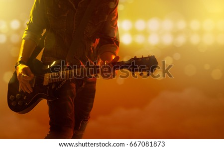 Musician playing electric guitar on the stage concert ストックフォト ©