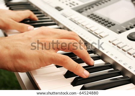 Musician playing on keyboards.