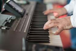 Musician playing on keyboards.Hands playing