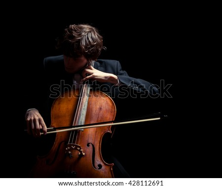 musician playing the cello. Black background #428112691