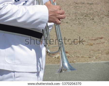 Musician playing the trumpet in a sunny day . Musical concept #1370206370