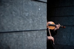 Musician playing violin on the street