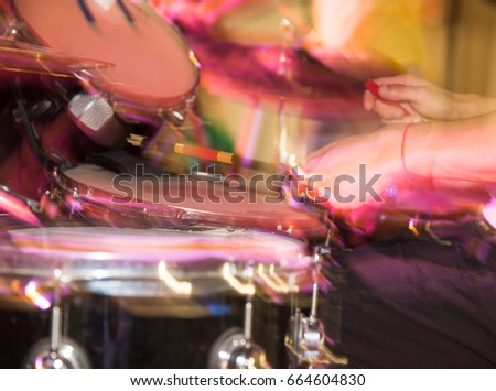 Musician plays drums in a rock band #664604830