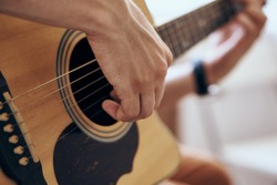 Musician plays the guitar, strings, chords, rock
