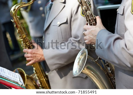 Musician, selective focus on the hands with saxophone