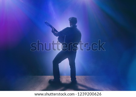 Musician with guitar on stage #1239200626