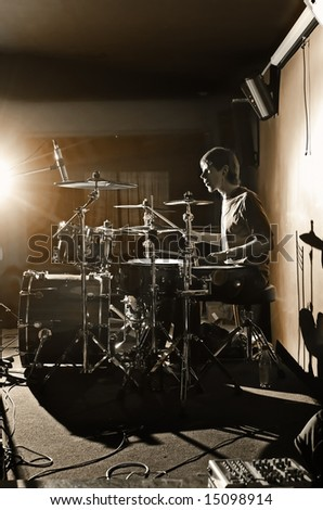 musician with set drum on scene of the club
