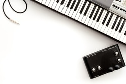 Musician work set with synthesizer, note  and headphones white table background top view space for text