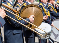 musicians of the military brass band plays the musical instruments