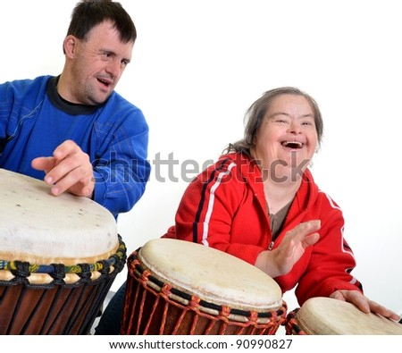 http://image.shutterstock.com/display_pic_with_logo/94683/94683,1324153669,2/stock-photo-musictherapy-couple-with-down-syndrome-playing-on-djembe-90990827.jpg
