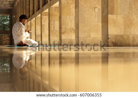 Muslim adult man praying in Istiqlal mosque Indonesia