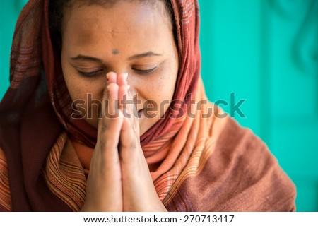 Muslim and Christian women praying together