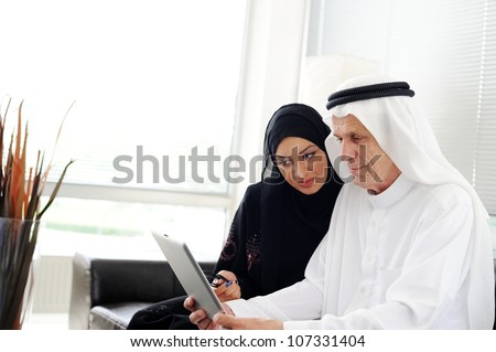 Muslim Arabic couple using Tablet computer