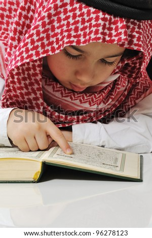 Muslim boy reading Koran