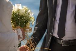 Muslim bride in  holds a wedding bouquet  , wedding details , in white wedding dress