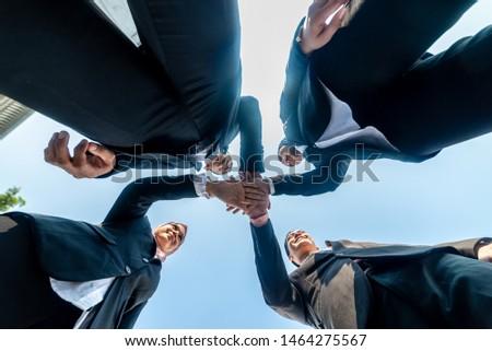 Muslim Business People join hands together. Team Teamwork Togetherness Collaboration Concept.