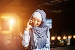 Muslim business woman on phone over conference
