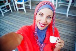 muslim caucasian woman taking selfie
