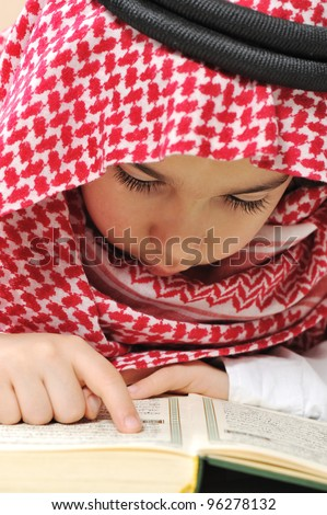 Muslim child with Koran