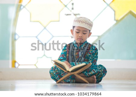 Reading Holy Quran(Islamic Book) on wooden table Images and Stock