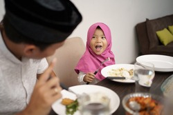 muslim family dinner break fasting together at home during ramadan