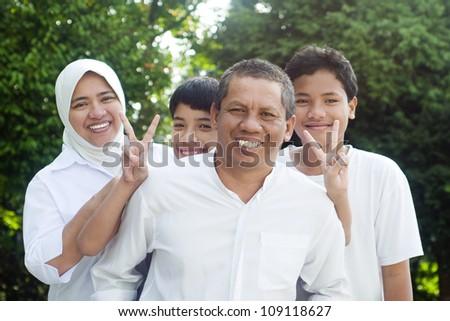 muslim family having outdoor fun