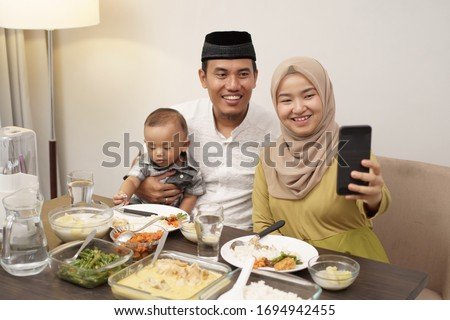 muslim family make video phone call while dinner at home