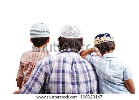 Muslim family with their back turned to camera