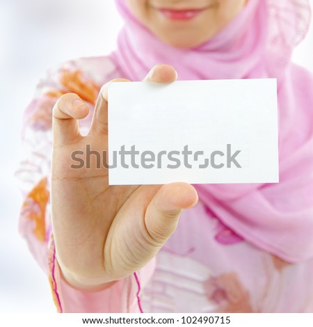 Muslim female holding business card, focus on hand
