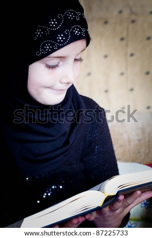 Muslim girl reading Koran