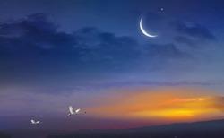 Muslim half moon and beautiful sunset . Light in dark sky . beautiful cloud . Ramadan background .  Mubarak background . Prayer time .  Dramatic nature background . Arab night