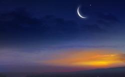 Muslim half moon and beautiful sunset .Sunset over the city . Light in dark sky . beautiful cloud . Ramadan background .  Mubarak background . Prayer time .  Dramatic nature background . Arab night