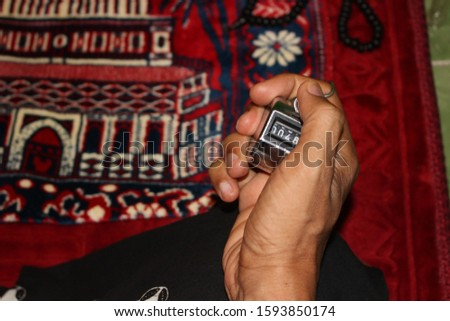 Muslim hands use counters to pray