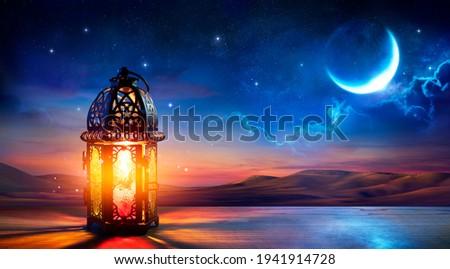 Muslim Holy Month Ramadan Kareem - Ornamental Arabic Lantern With Burning Candle Glowing At Evening
