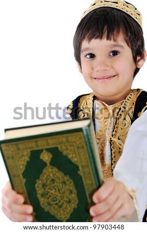 Muslim kid holding holy Qoran