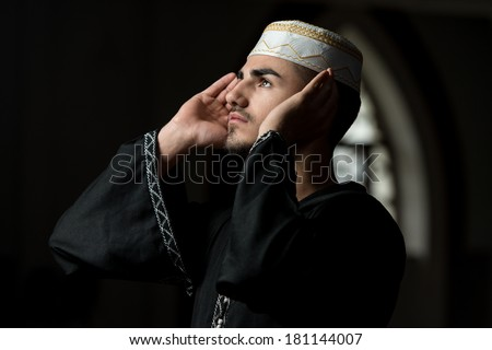 Muslim Man Is Praying In The Mosque Guy Making Traditional Prayer To God While Wearing A Traditional Cap Dishdasha
