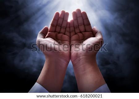 Muslim man praying - Shutterstock ID 618200021