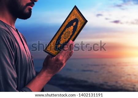 Muslim man reading holy quran