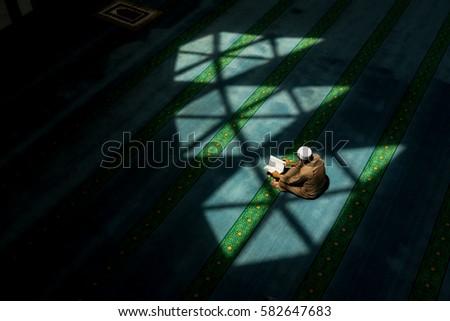 Shutterstock Muslim man recite (reading) the Quran