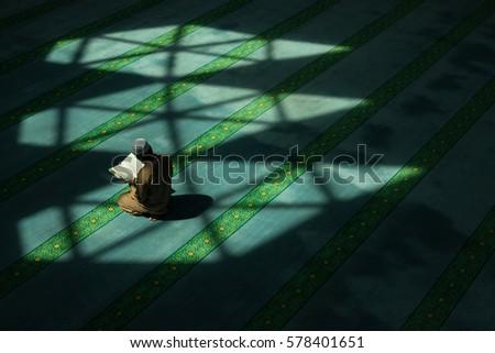 Shutterstock Muslim man recite the holy Quran