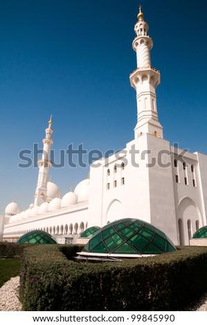 Muslim mosque in Dubai against blue sky