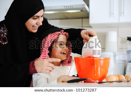 Muslim mother and little son in the kitchen